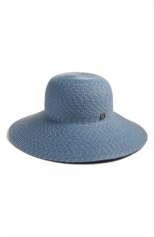 An elegant broad-brim sun hat woven from airy lightweight straw from Eric Javits