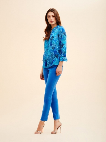 Ruffled neck blouse with tassel tie front from the Carlisle Collection.