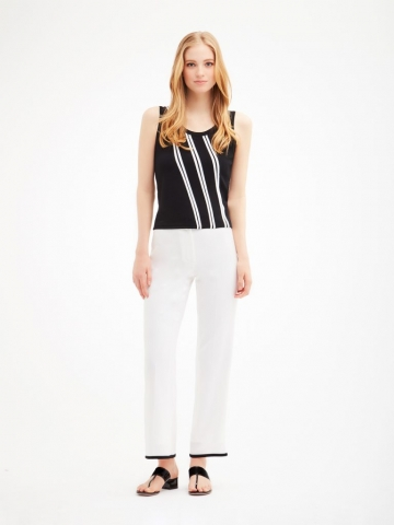 Pure white crepe wide-leg pants tipped in black from Carlisle Collection.