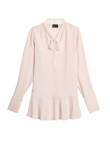 Feminine ruffles define the crepe pullover blouse from Carlisle.